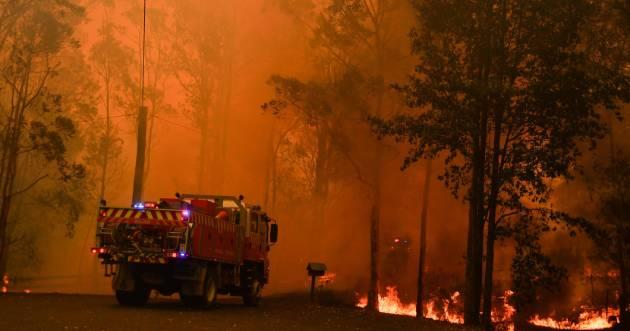 Fire trucks are seen during a bushfire in Werombi, 50 km southwest of Sydney, Australia, December 6, 2019. AAP Image/Mick Tsikas/via REUTERS