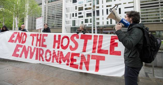 Monday April 30, 2018. Protestors from Global Justice Now demonstrate outside the Home Office in London demanding an end to the Hostile Environment policy, ahead of parliamentary debate on the Windrush scandal. Photo: David Mirzoeff/Global Justice Now