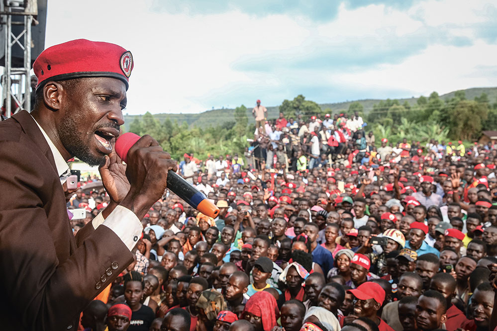 Robert Kyagulanyi, also known as the popstar Bobi Wine, speaks during a rally in Hoima in the west of Uganda. OPA IMAGES/SIPA USA/PA IMAGES