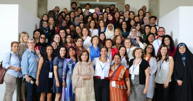Sanam Naraghi-Anderlini (bottom, centre, in white top) with women peacemakers from conflict zones from around the world at ICAN's 2018 Annual Forum in Sri Lanka. Credit: ICAN