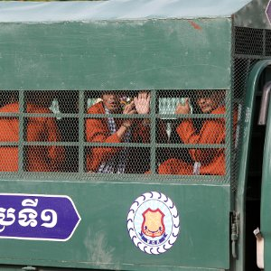 Members of the dissolved opposition Cambodia National Rescue Party inside a police vehicle in Phnom Penh.