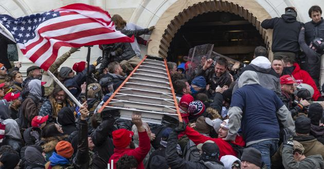 January 6, 2021, Rioters attempt to enter break in to the Capitol building through the front doors. (Credit Image: � Lev Radin/Pacific Press via ZUMA Wire)