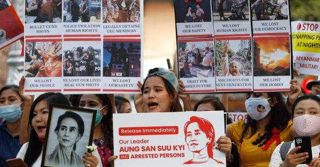 Myanmar citizens hold placards in front of the United Nations building during the demonstration. Protesters gathered in front of the United Nations building to protest against the military coup and demanded the release of Aung San Suu Kyi. Myanmar's military detained State Counsellor of Myanmar Aung San Suu Kyi on February 01, 2021 and declared a state of emergency while seizing the power in the country for a year after losing the election against the National League for Democracy (NLD). (Photo by Chaiwat S