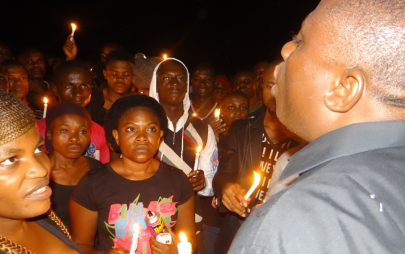 Celestine AkpoBari speaks at a vigil for the Ogoni 9.