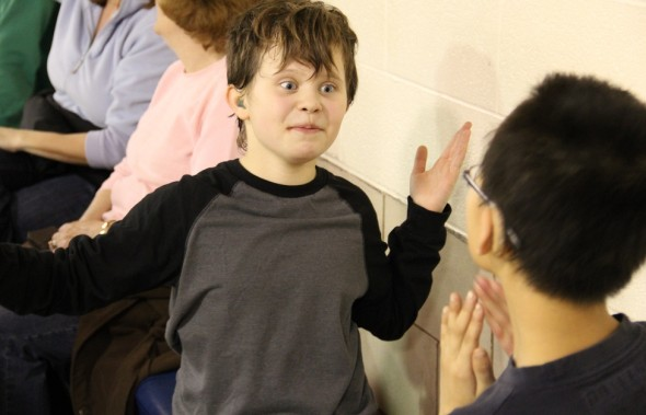 Child using sign language