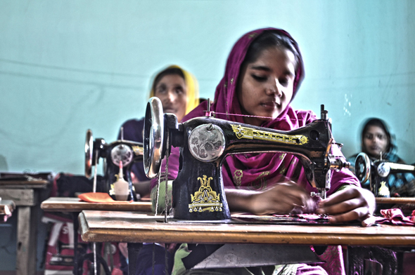 Bangladeshi_women_sewing_clothes.jpg