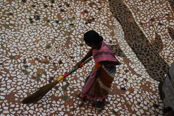 Indian woman sweeping