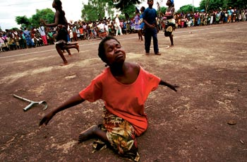 A landmine victim in Angola dances during festivities for the International Day of the Disabled. Despite vast reserves of petroleum, diamonds and natural resources, decades of civil war has riddled Angola with unexploded ordnance, impoverishing and crippling the population.