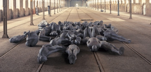 Antony Gormley CRITICAL MASS II, 1995 Cast iron 60 life-size elements; variable sizes Installation view, StadtRaum Remise, Vienna Photograph by Stephen White, London © the artist