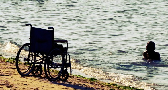 Wheelchair on beach [Related Image]