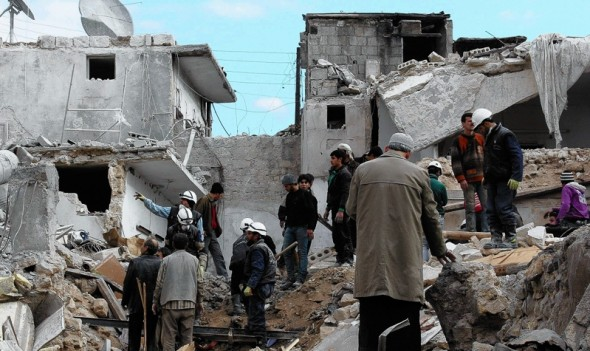 Rescuers after a Syrian air raid