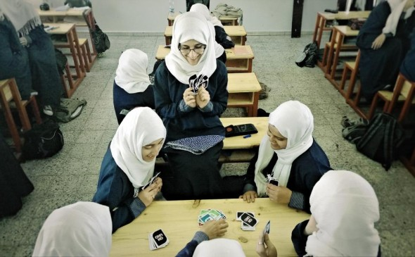 Yemeni girls playing a card game