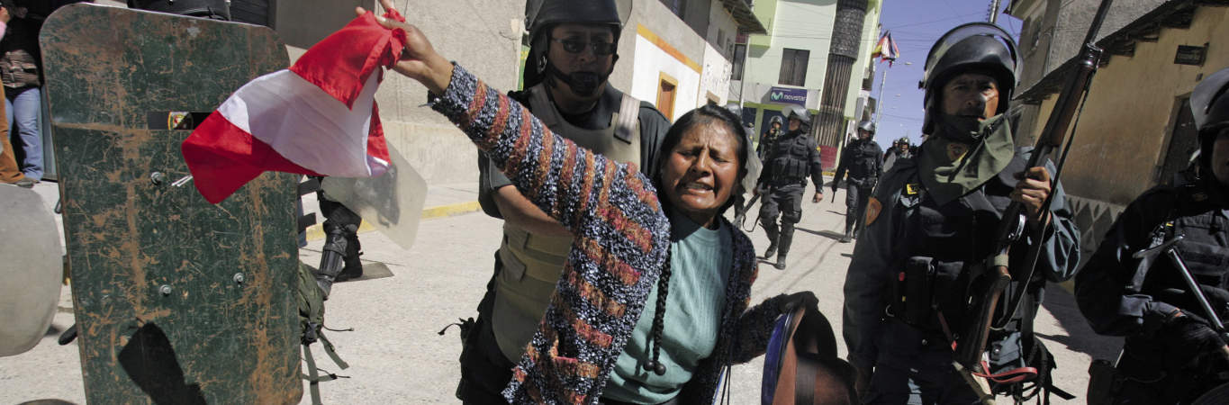 https://newint.org/sites/default/files/field/image/2017-09-01-peru-police-1365.jpeg