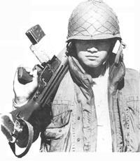 A Salvadorean soldier clad in US-supplied bullet-proof jacket. Photo: Camera Press