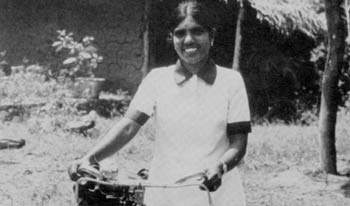 'The most familiar of village sights' - Kantha bikes her way toward smaller families. Photo: Peter Armstrong