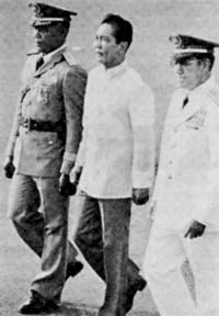 President Marcos and military aides.