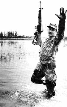 A Nicaraguan National Guardsman under the regime of former dictator Anastasio Somoza trains in the Florida swamps. Hundreds of ex-guardsmen are bow trying to overthrow the current Sandinista government. President Reagan recently referred to these 'counter-revolutionaries' as 'freedom fighters' - a reflection of the use of language in influencing opinion.