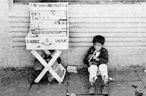 Children get involved in the tabacco industry at an early age - selling Lark cigarettes in Ecuador.