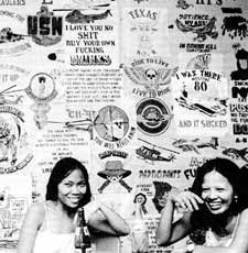 Prostitutes in an Olongapo bar. The obscene wall designs are from Gis' T-shirts.