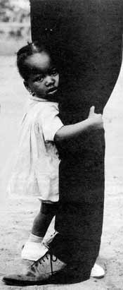 A child evokes protectiveness without a word. The question is whether her father will respond to her need.