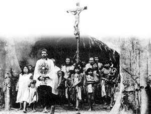 The cross and the fire - Father Gabriel leads the Guarani out of the Mission to face the soldiers.