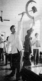 Waiters in Canton station perform a dance tribute to the thoughts of Mao.