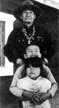 Navajo elder and granchildren: Indian lands seen as new resource frontiers.