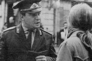 Soviet cop checks a passport: one way to keep workers in place.