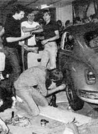 Danger - teenagers tuning up their cars.