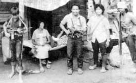 Family at war: Filipino guerillas in A Rustling of Leaves.