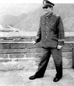 General Chen Chung Kwei and his men helping peasants hoe the fields in 1971. If he could have looked through time at his late 1980s counterpart, would he have been scornful of his sunglasses, his insignia of rank, his fat-cat complacent air? Or should we ask instead if the General really made a habit of such manual labour?
