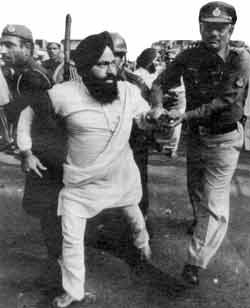 Police arrest a Sikh leader after a demonstration in New Delhi.