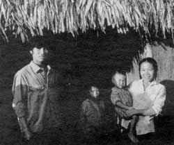 Tu, Lan and family - with their new house.