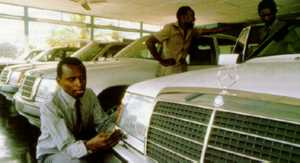 Luxury cars on sale in Lusaka, Zambia: multinationals are lobbying for unrestricted foreign investment rights.