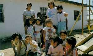 Frank's heaven on earth: women and children from the rubbish dump in Ciudad Juarez gather in the playground outside the day centre.