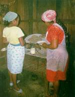 Summoned by trumpet (see below): Genaro's wife and daughter make tortillas for my lunch. Photo by David Ransom