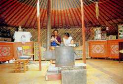 Ger-r-r-eat! A Mongol family relaxes inside their ger on the outskirts of Ulaan Baatar.
