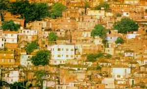 Rochinha, one of Brazil's largest shantytowns on the edge of Rio de Janeiro. Industrial development has destroyed rural communities and disrupted traditional social relationships.