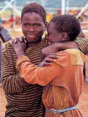 Fruits of the 'expanding circle': good friends are reunited at a Rwandan refugee camp in Tanzania.