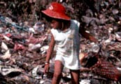Photo of a child picking through a rubbish heap by Heldur Netocny/Still Pictures