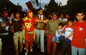 Corpulent caped crusader: Super Barrio at work in Mexico City.