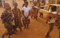 These children from Mali even have to buy their own desks and carry them home for the holidays.