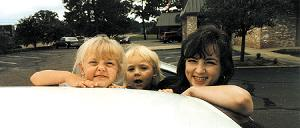 Above are Amy West and her daughters. The younger one suffers from Goldenhar's Syndrome.
