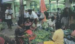 Market madness - women sell local produce in Jayapura while the Government sell their land in Jakarta.