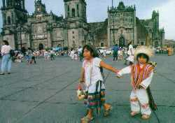 Gentle persuasion: indigenous children in Mexico City's Zocalo Square.