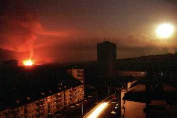 Flare of terror: NATO bombs light up the sky over Belgrade.