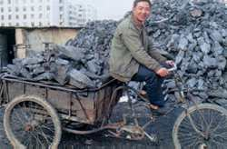 Trading by tricycle - a charcoal dealer from Yunnan Province.