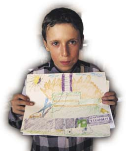 After the meltdown: a Ukrainian boy holds a drawing of the Chernobyl nuclear disaster.