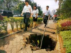 Jakarta residents step around a crumbling walkway. Countries which spend most of their foreign exchange on debt service could be helped by an International Clearing Bank.