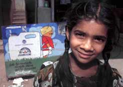 Signed up: South Indian girl outside a shop selling seeds and pesticides.